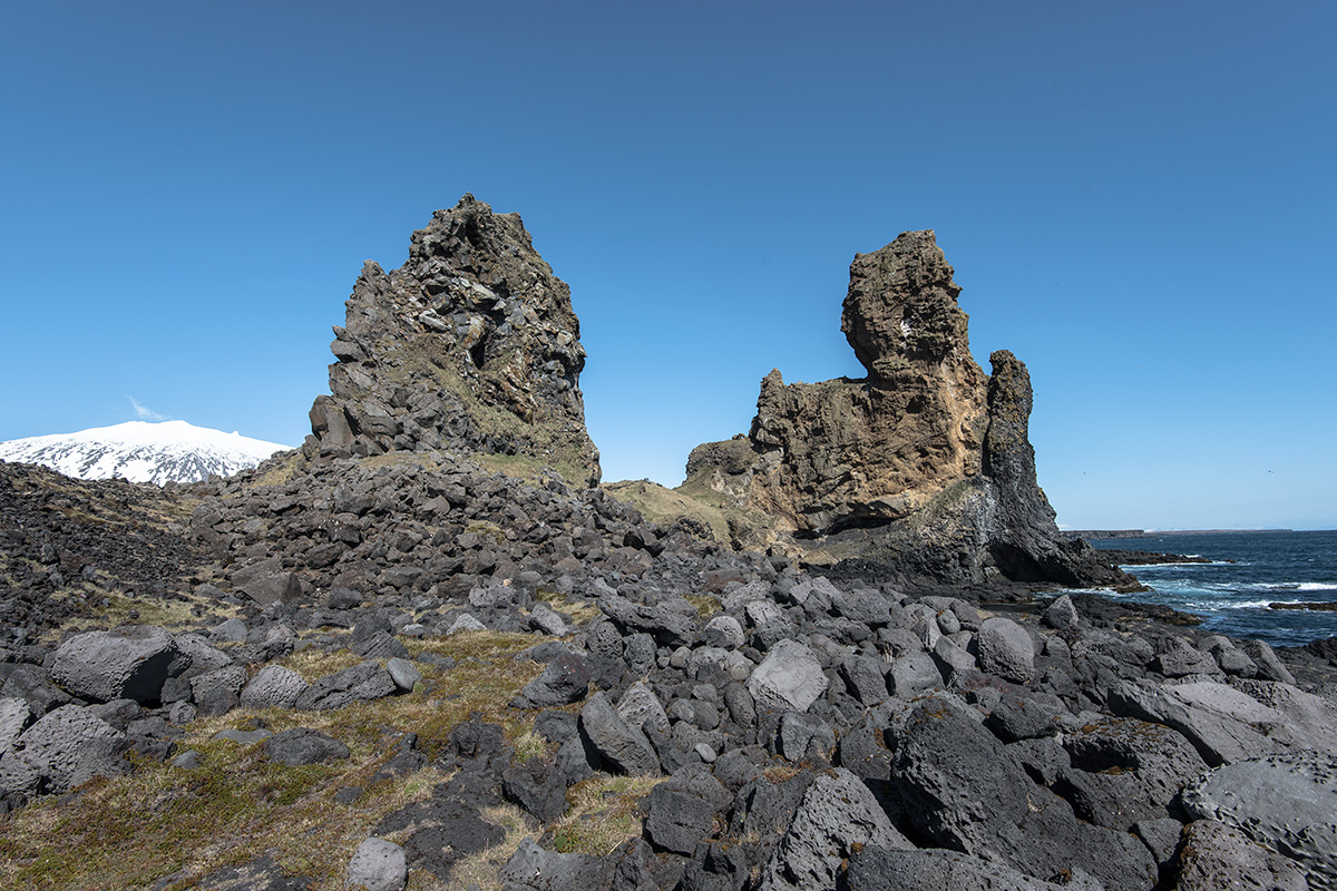 Lóndrangar are spectacular stacks by the coast at Snæfellsnes Peninsula