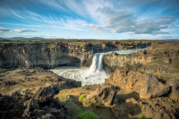 The 20-meter high waterfall Aldeyjarfoss in the river Skjálfandafljót is a powerful stream of glacial water forcing its way from the Icelandic Highland