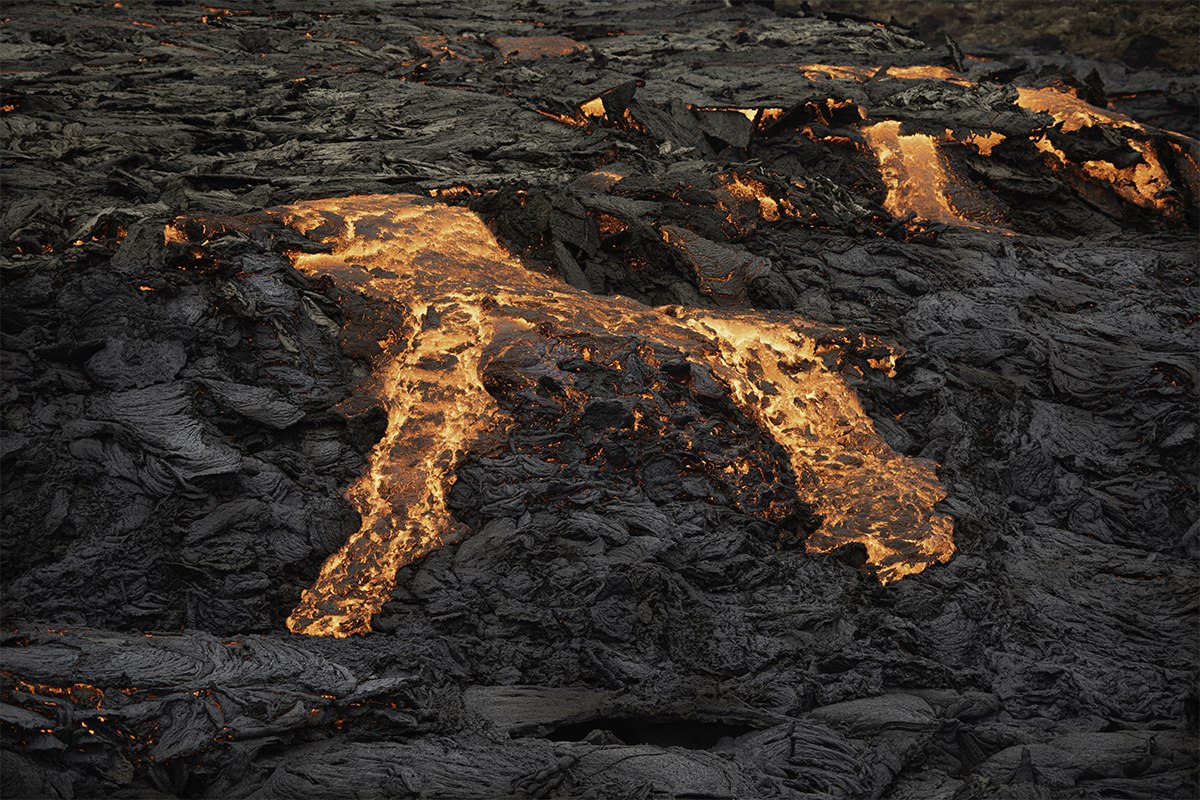 Lava flowing from the crater in rivers of fire