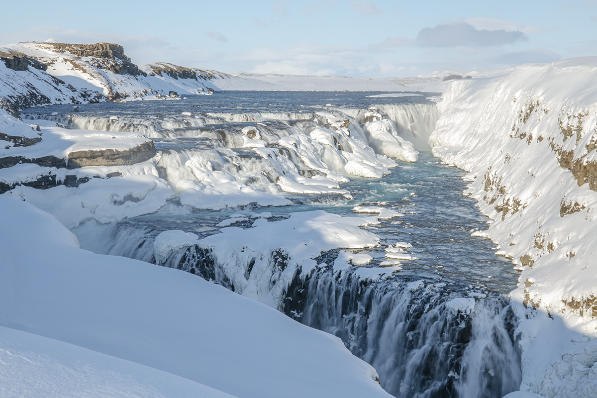 Gullfoss in late winter when the volume is at minimum and the blue color is quite visible