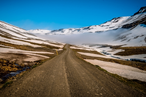 Even a gravel road covered with dark fog for miles at the top of a mountain