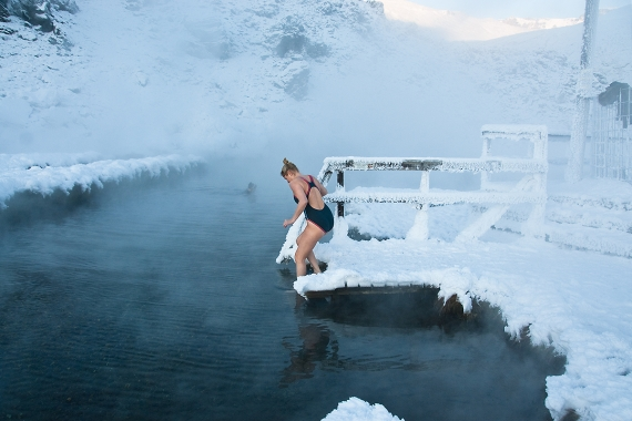 Warm natural pool on a cold day in the Highland of Iceland