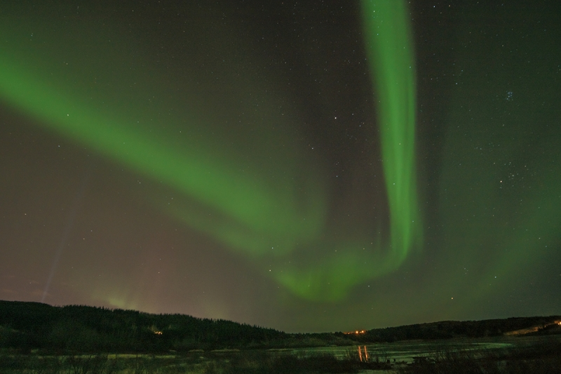 The Northern Lights Or Aurora Borealis Appear On