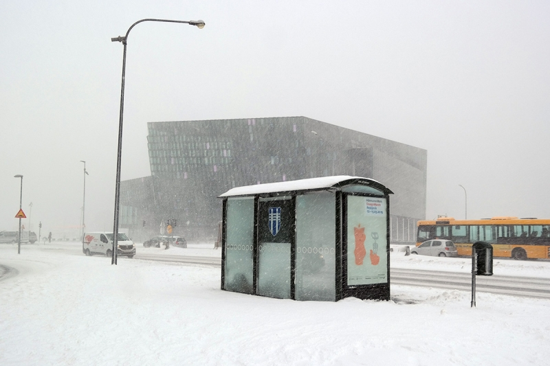 In the storm the concert and conference hall, Harpa almost disappeared in the snowstorm.