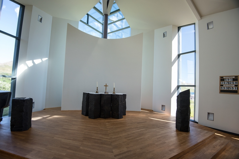 Hreinn Friðfinnsson, who lives and works in Amsterdam that designed the altar and the altar-peace