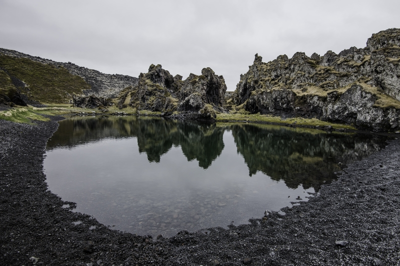 This strange black sand cove on the south coast of the Snæfellsnes Peninsula is curiously close to the Icelandic heart. It is covered with black pearly pebbles, constantly being brought in by the ocean waves.