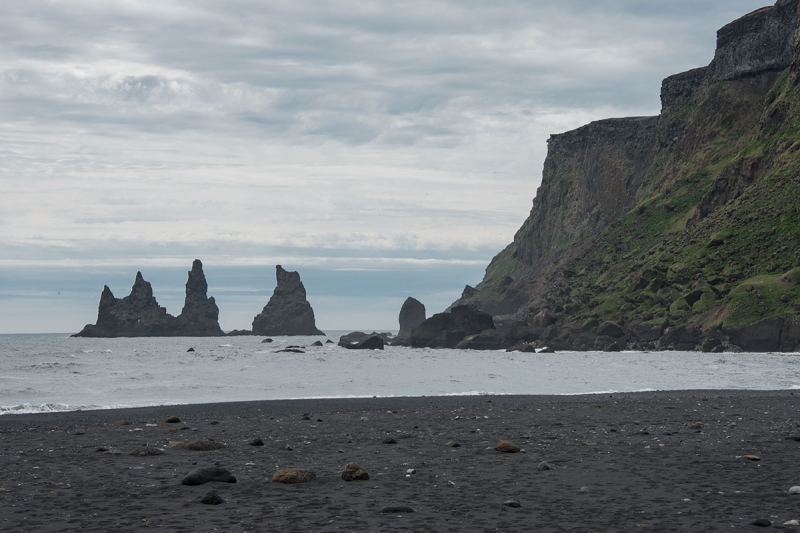 Everyone visiting Reynisfjara should BE CAREFUL. Reynisdrangar seen from the village Vík.