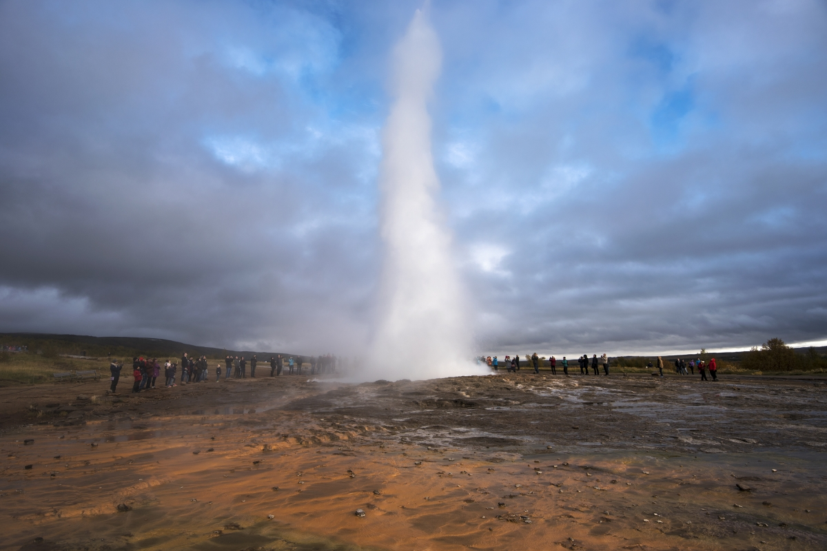 Geysir hot spring is often crowded during summer viewing the Strokkur hot spring erupt